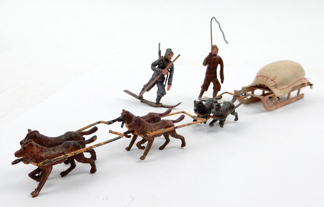 Dog Sled with harnessed dogs, driver with whip, and a s