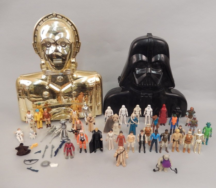 Collection of Star Wars action figures in cases,