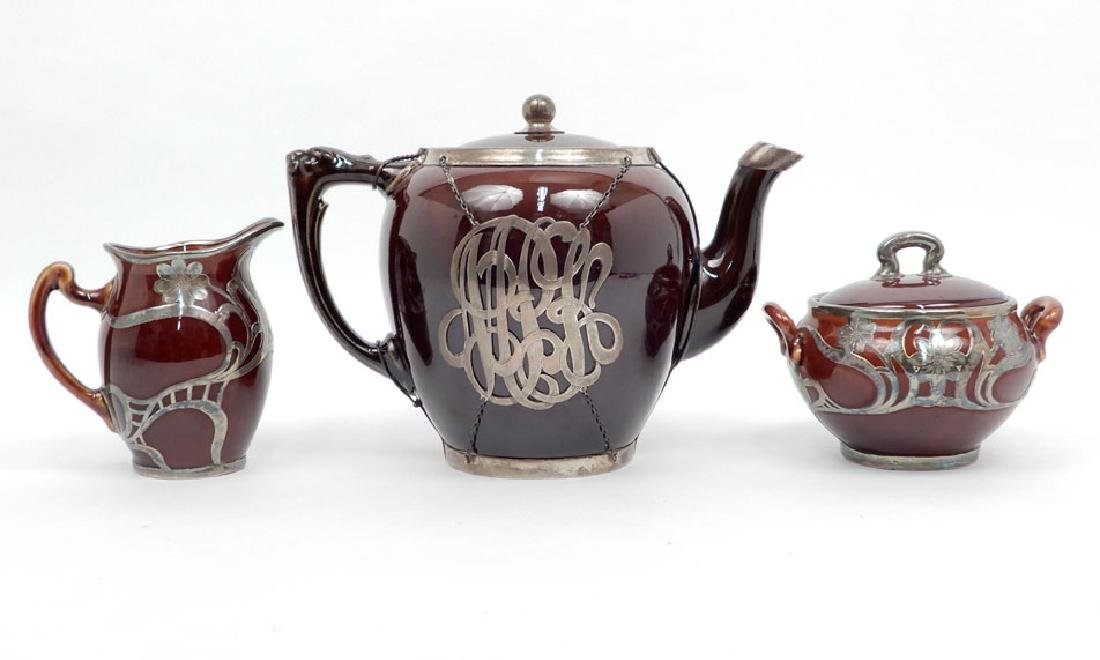 Three piece Lenox tea set with sterling overlay