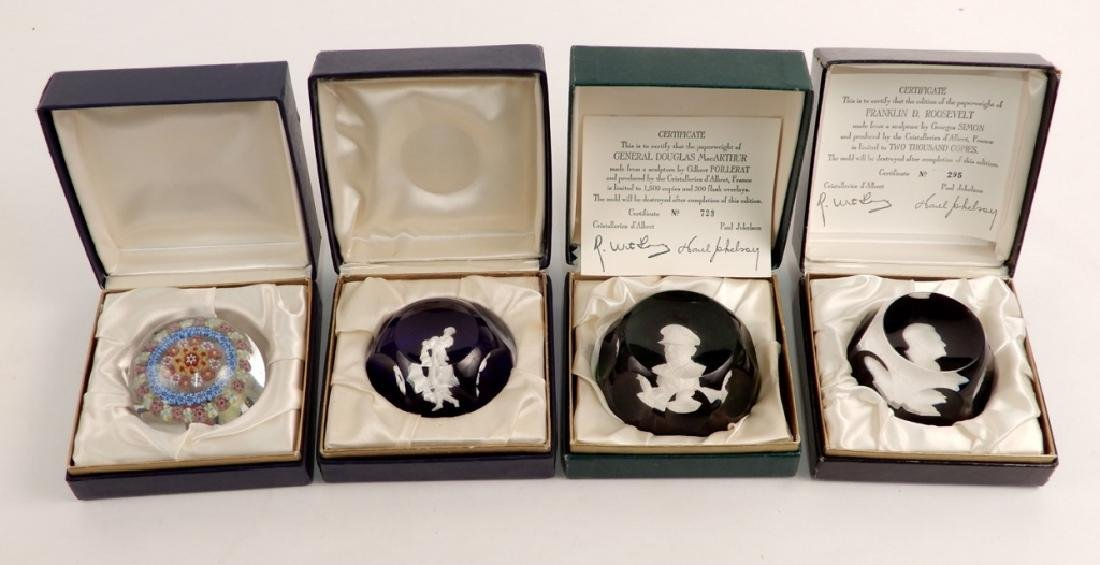 Four art glass paperweights in boxes