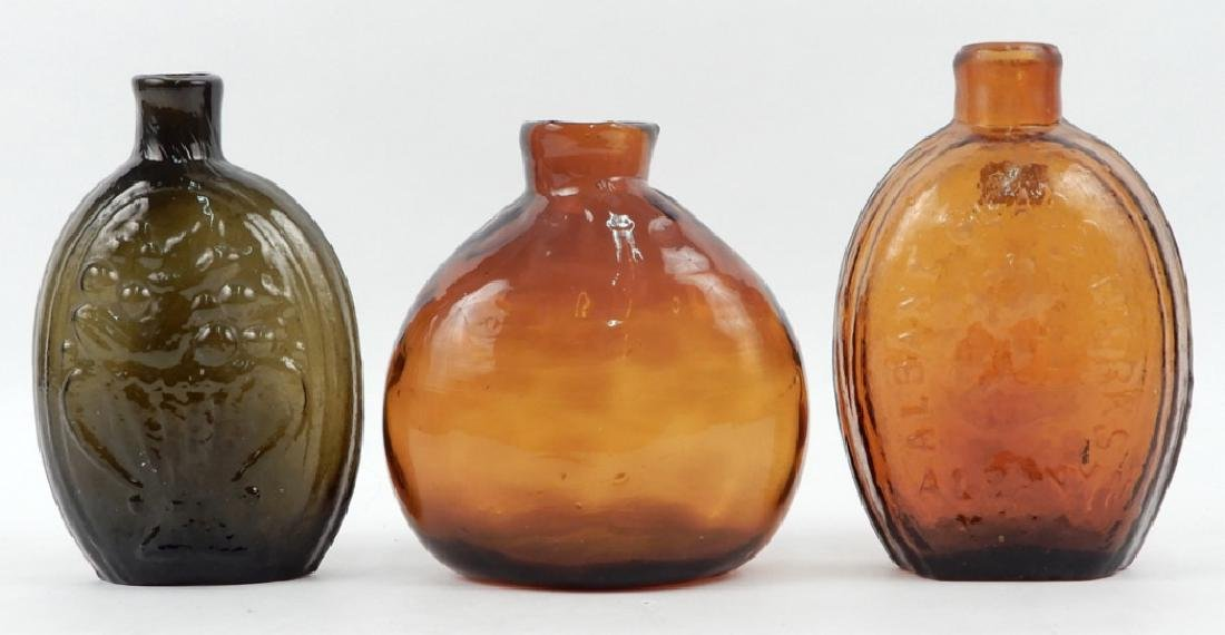 Three mold and free blown glass bottles