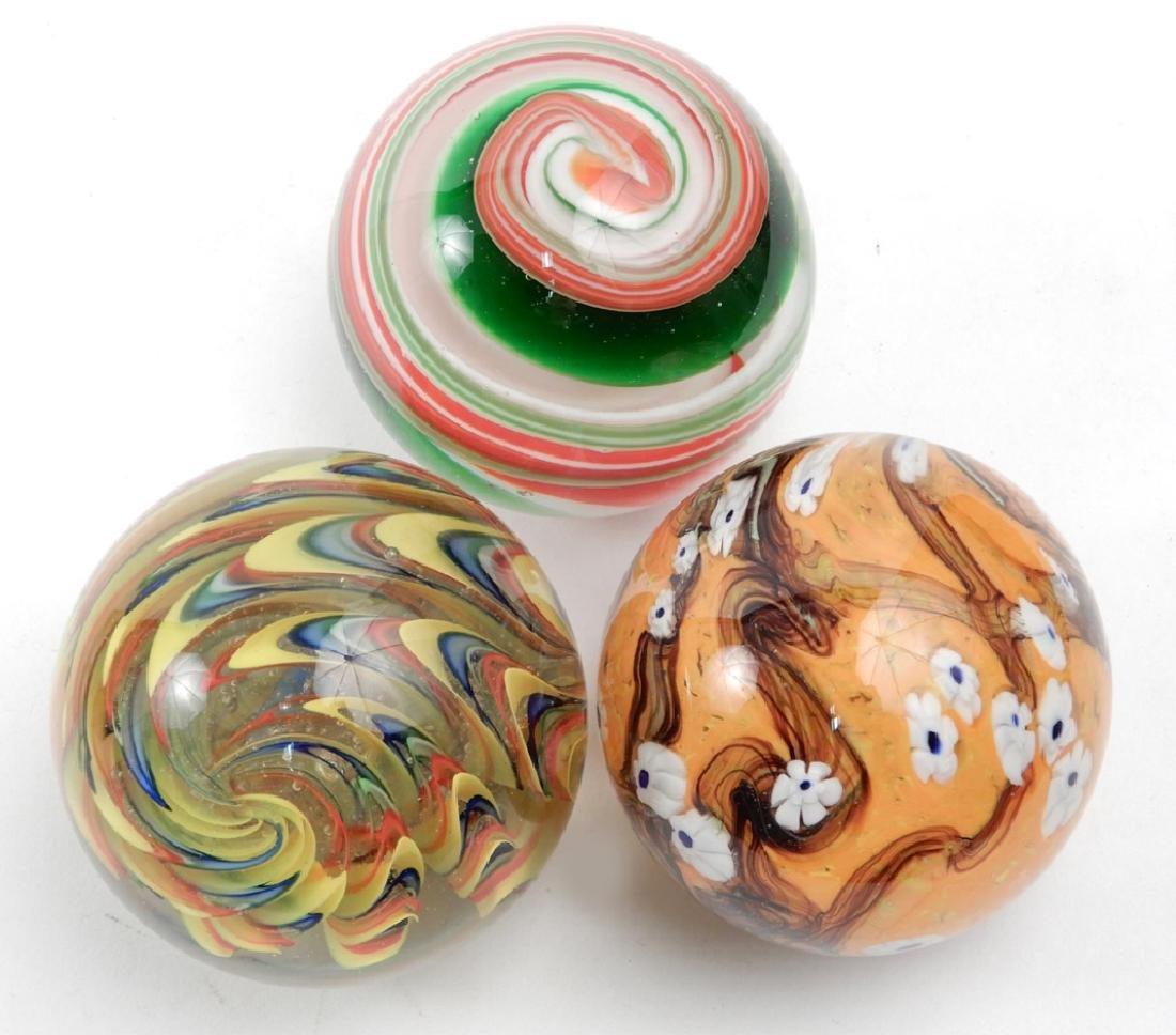 Three Tozai art glass paperweights