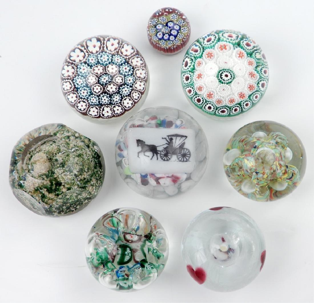 Seven art glass paperweights