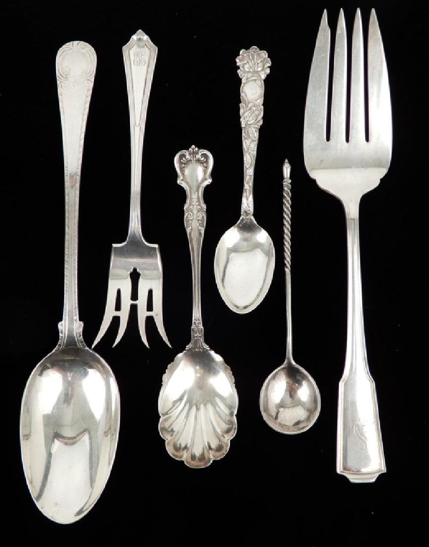 Grouping of silver flatware serving pieces