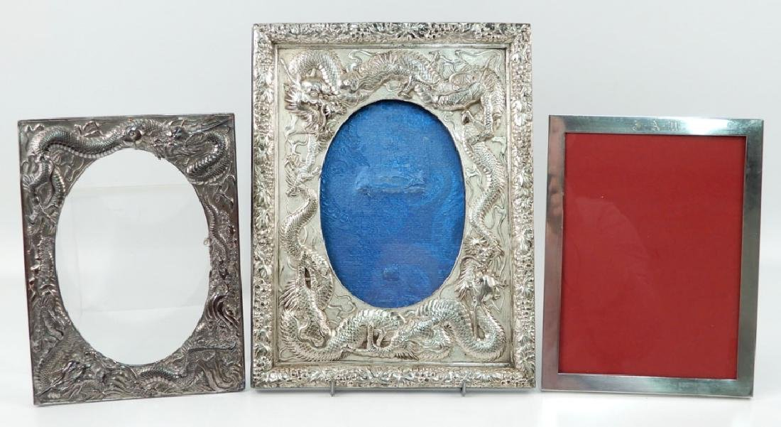 Sterling silver frame and two ornate silver plated