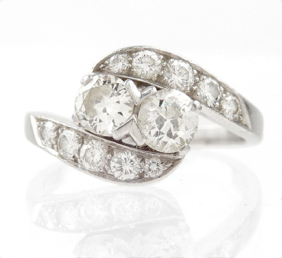 Vintage platinum and diamond crossover ring