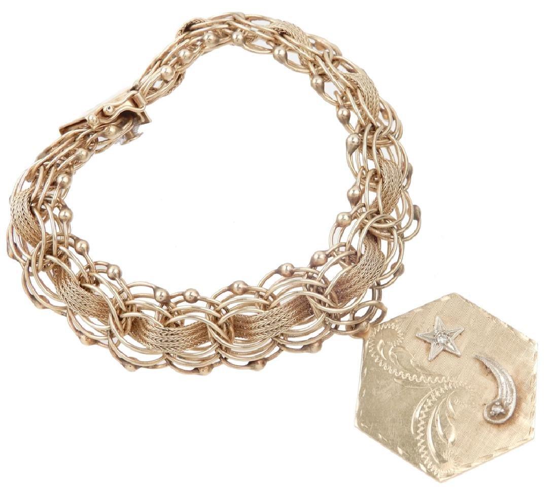 14k gold charm bracelet with charm