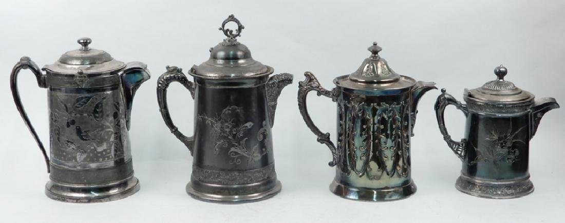 Four Victorian silver plated cold water pitchers