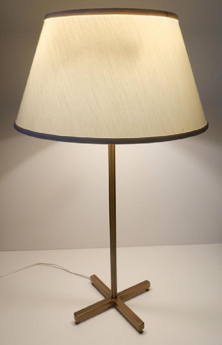 Mid C. brass lamp