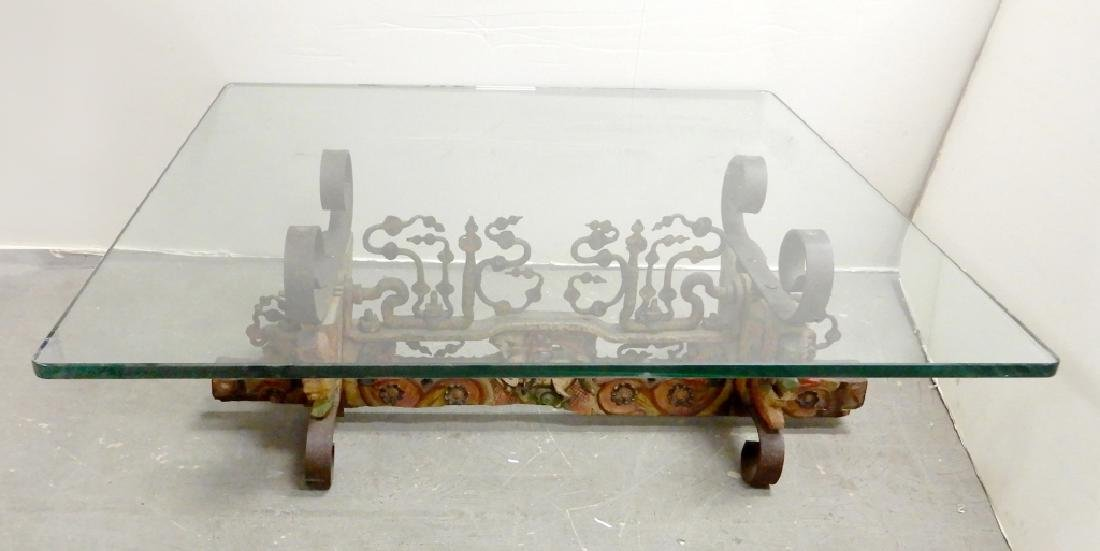 Wrought iron and carved wood table