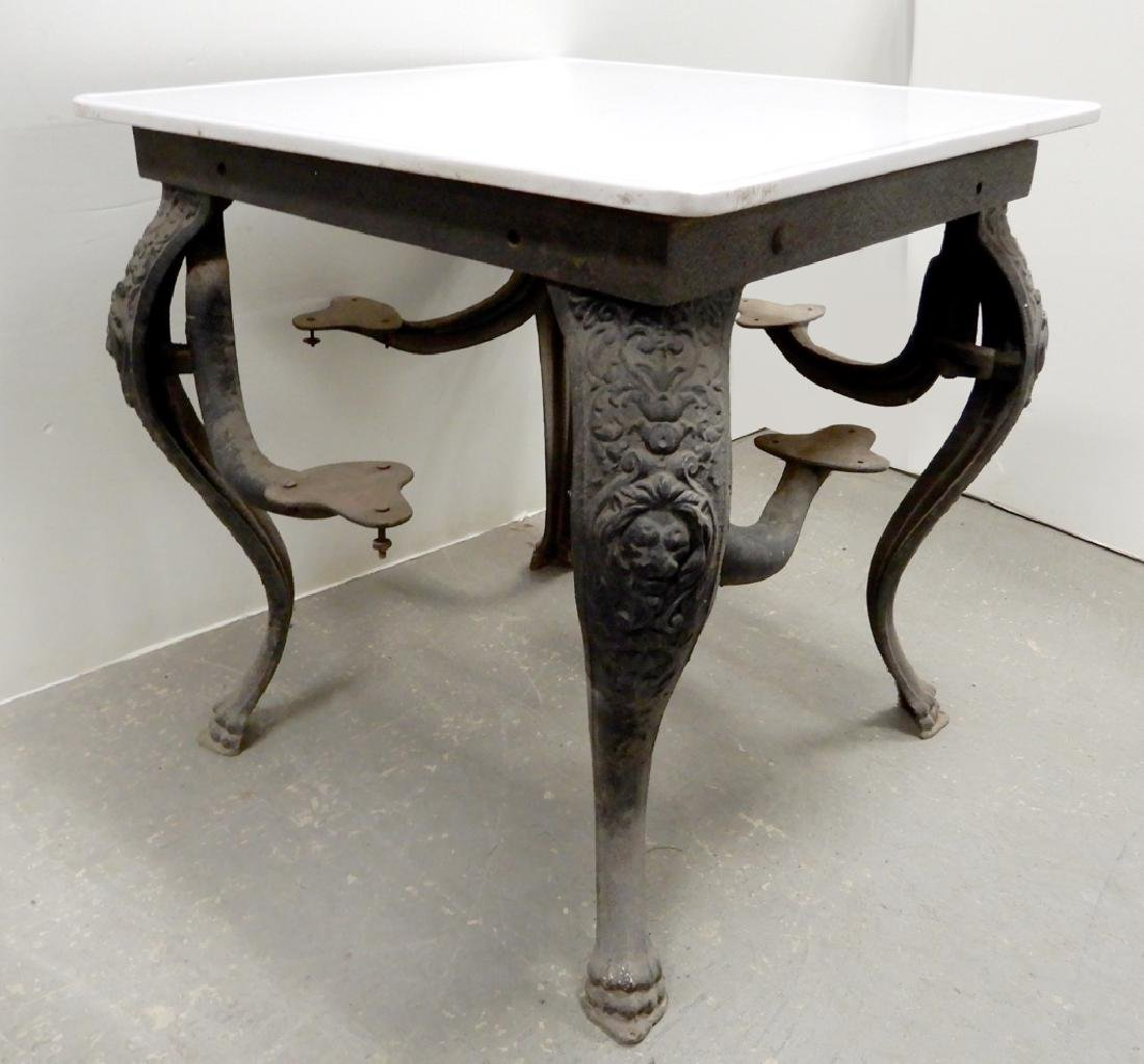 Cast iron soda fountain table with swing out seats