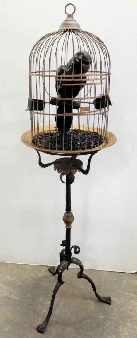 Ceramic bird in brass cage on wrought iron stand