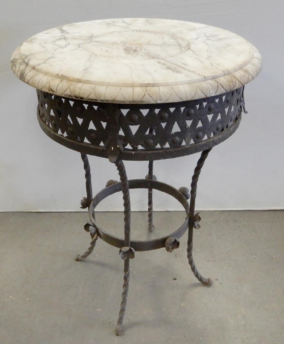 Iron table with carved marble top