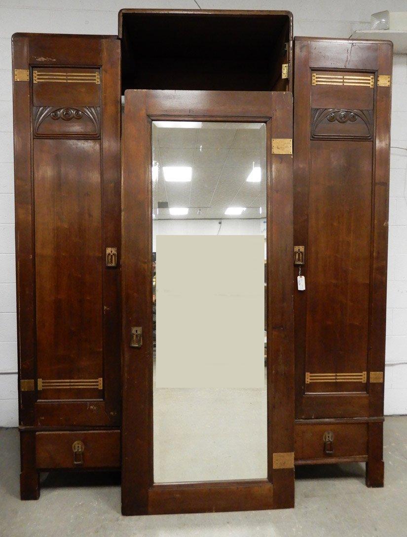 Walnut Art Deco armoire, three doors, center door has b