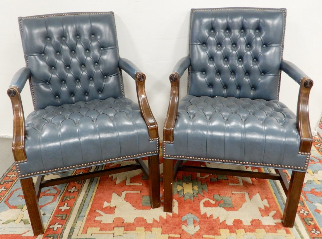 Pair of walnut and leather upholstered button tufted ch