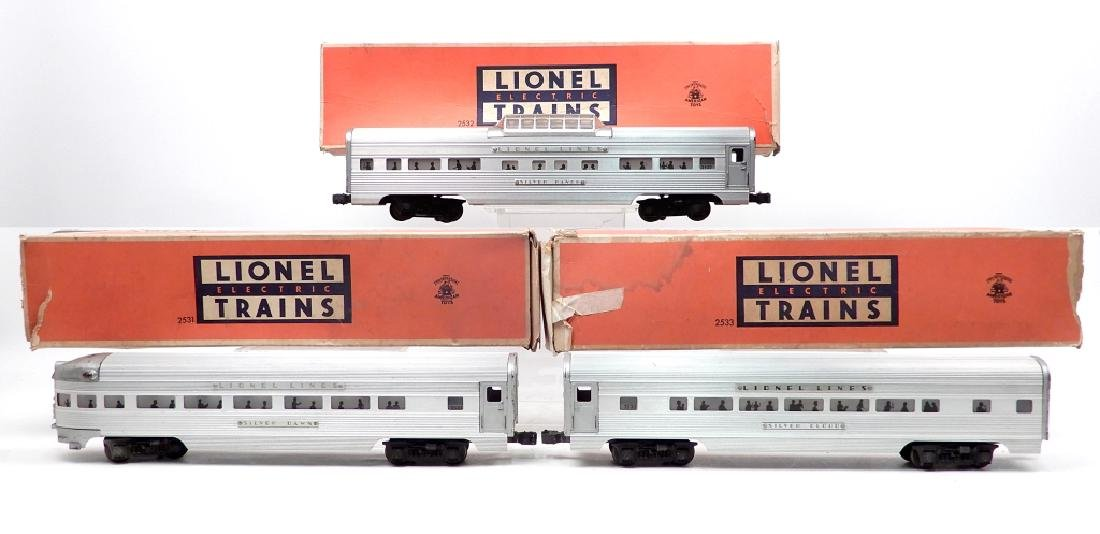 Three Lionel passenger cars in original boxes