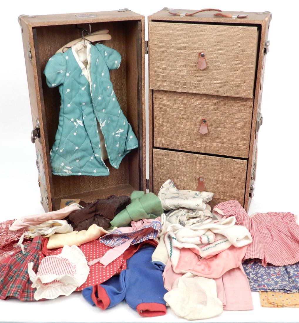 Vintage 1940's doll travel trunk with early clothes