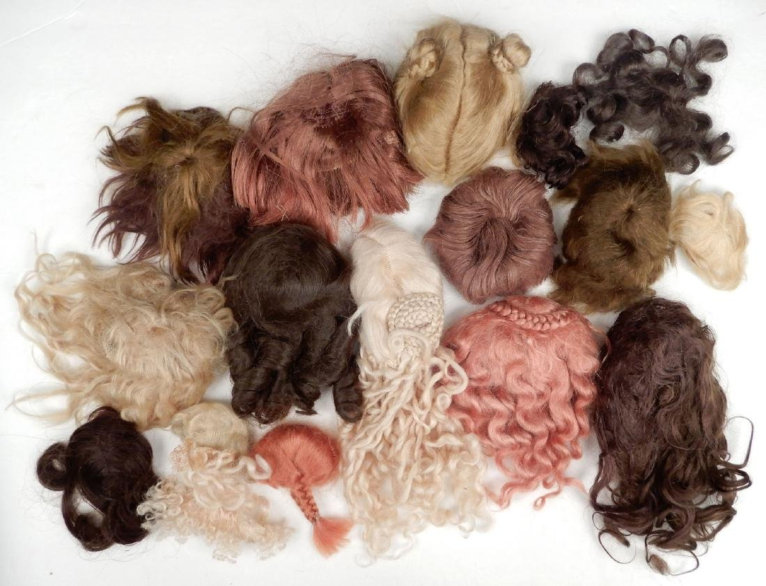 Grouping of antique and vintage doll wigs