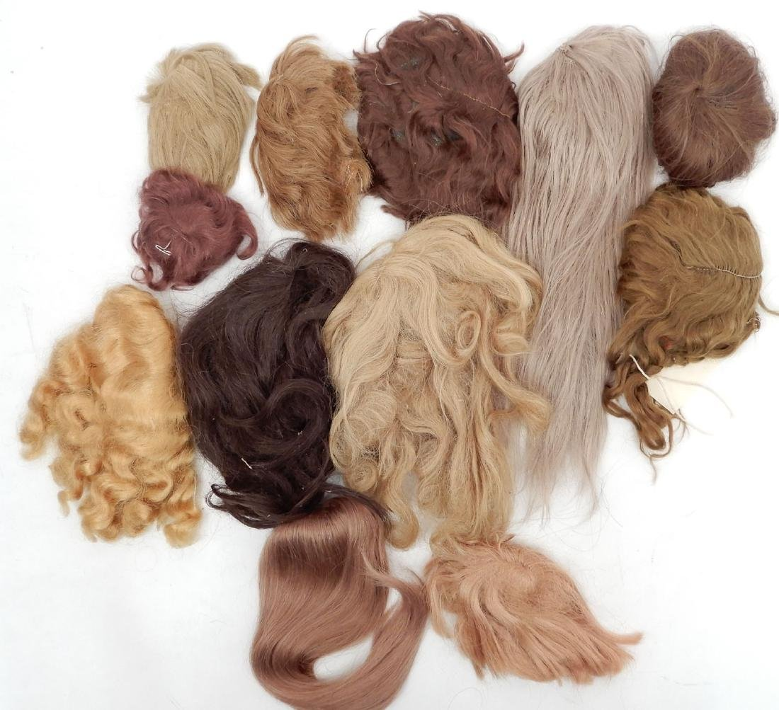 Grouping of doll wigs
