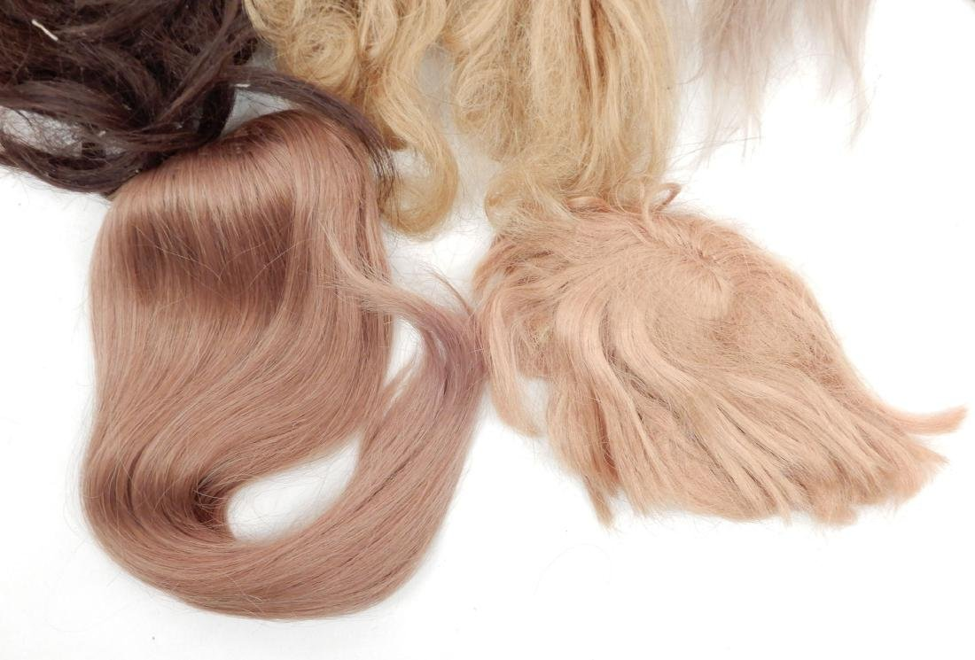Grouping of doll wigs - 2