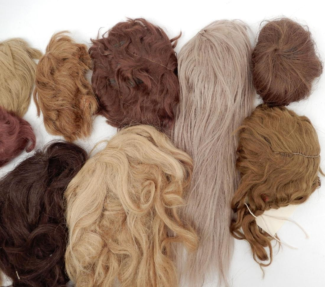 Grouping of doll wigs - 3