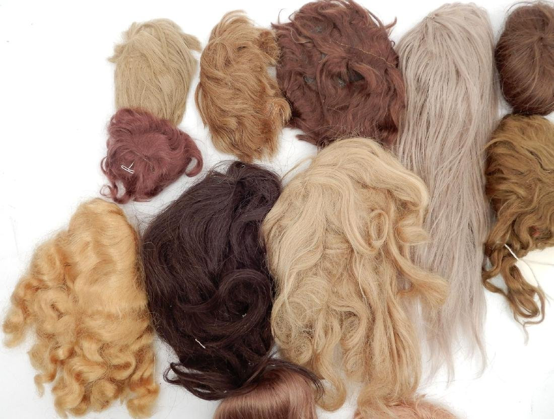 Grouping of doll wigs - 4