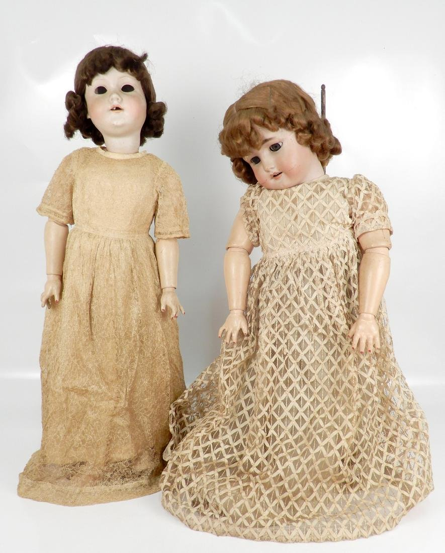 Two bisque socket head dolls with composition ball