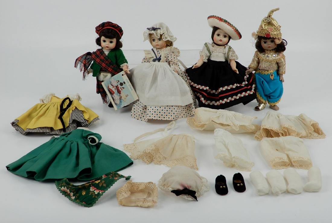 """Four Madame Alexander 8"""" dolls with assorted outfits"""