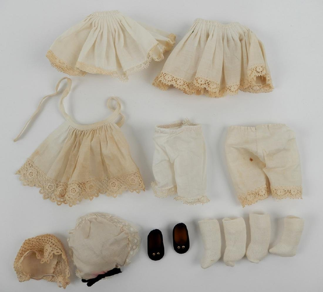 """Four Madame Alexander 8"""" dolls with assorted outfits - 4"""
