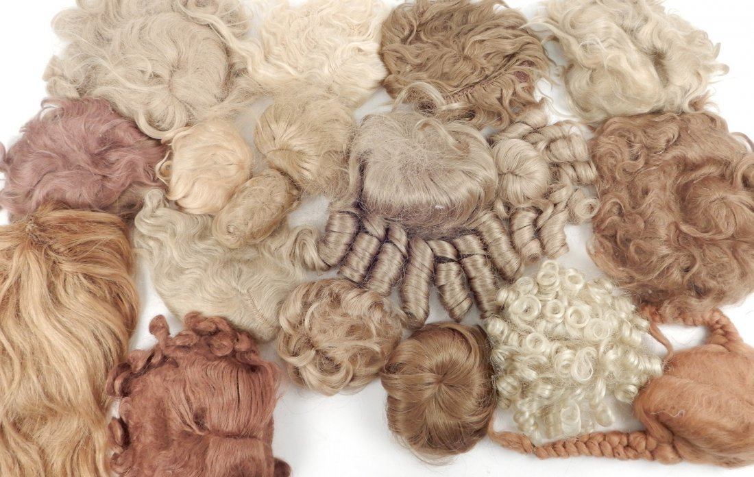 Large assortment of doll wigs, various sizes,