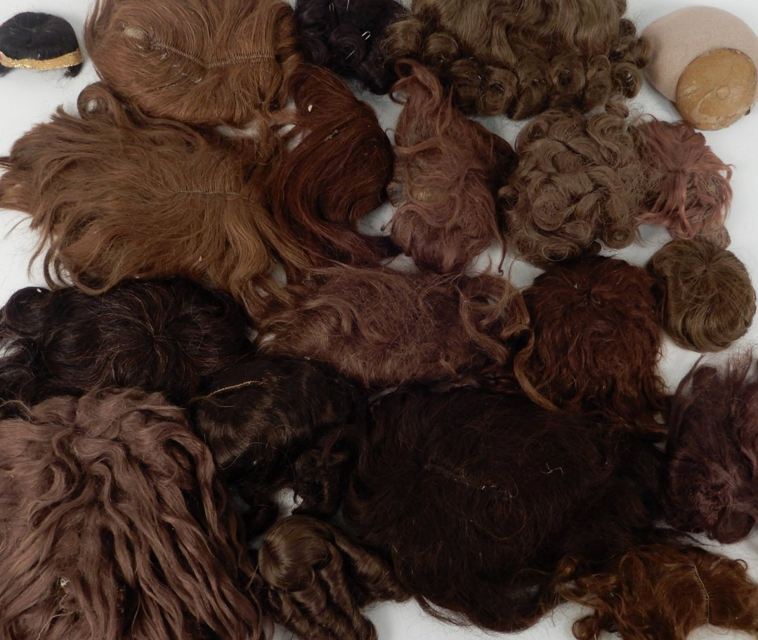 Large assortment of doll wigs, various sizes, - 2