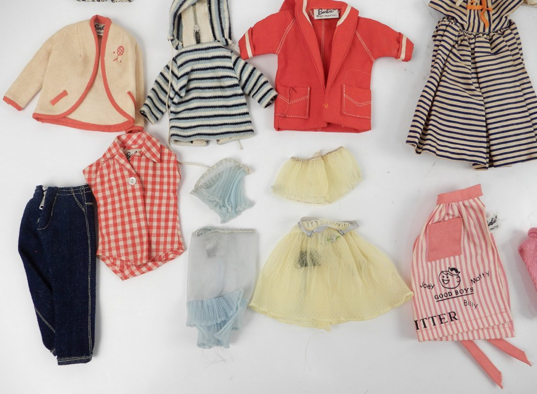 Large grouping of tagged Barbie doll outfits - 10