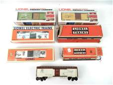 Five Lionel box cars with boxes