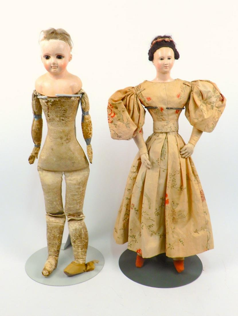 Two early paper mache dolls with kid bodies
