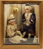 Vignette with two antique bisque German dolls