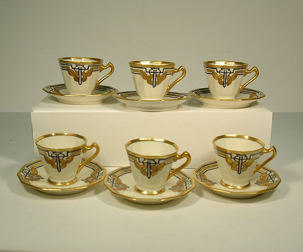 9: Set of six porcelain demitasse cups and saucers with