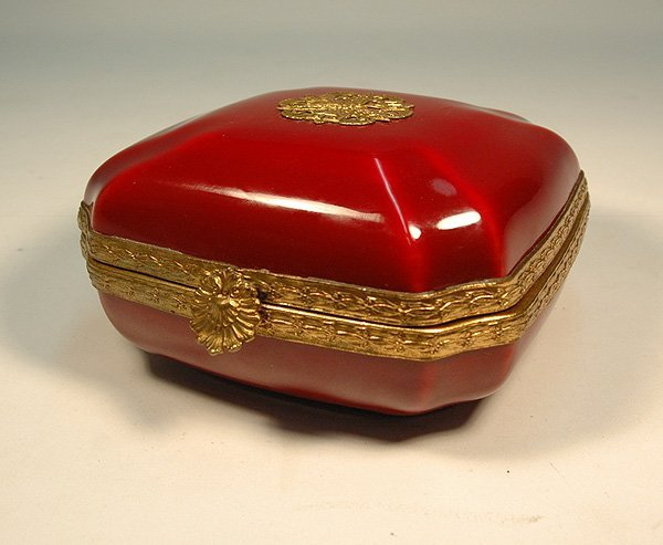 21: Sang de boeuf porcelain dresser box with bronze mou