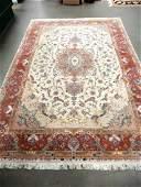 Fine Persian Tabriz carpet with silk flowers