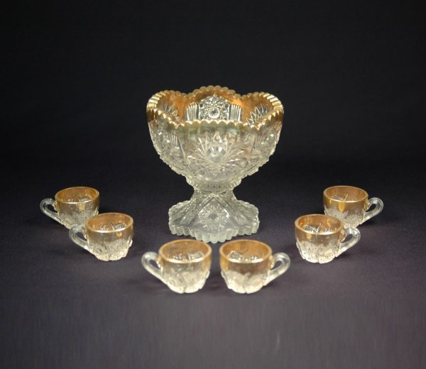7: Child's pattern glass punch bowl with six cups (one