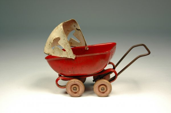 11: Pressed steel doll baby buggy, painted red and whit