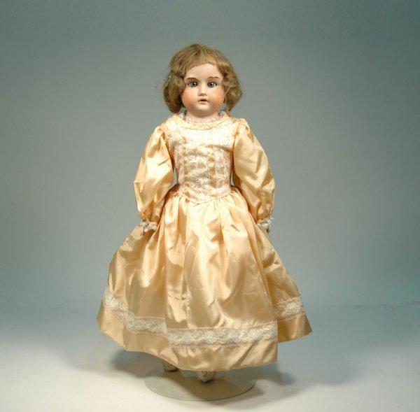 20: Bisque head doll, kid body, bisque hands, sleep eye