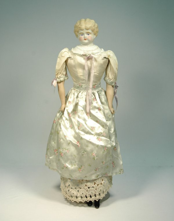 22:  Parian head doll, parian arms and legs, molded blo