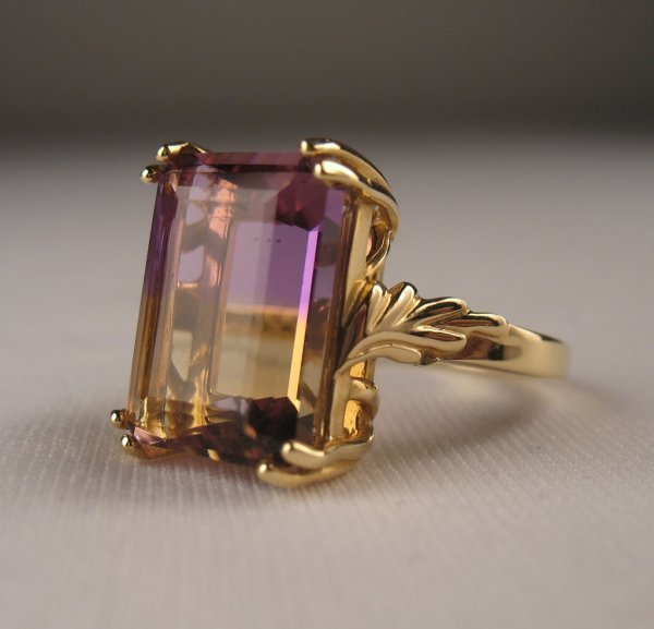 192: Contemporary 14k gold ring with emerald cut ametri