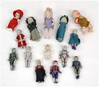 19: Fourteen small bisque dolls, four marked Germany i