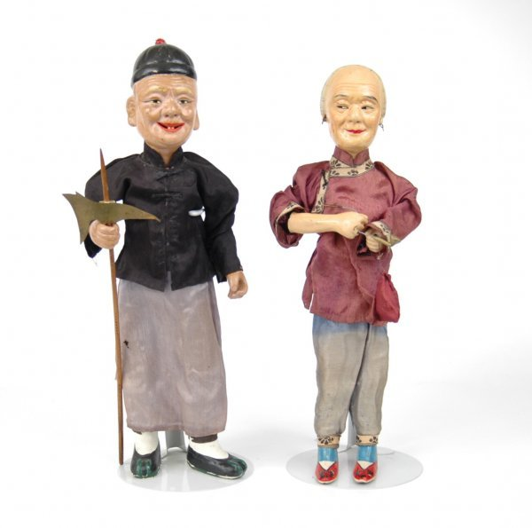 21: Pair of Oriental dolls, compo heads, clay arms and