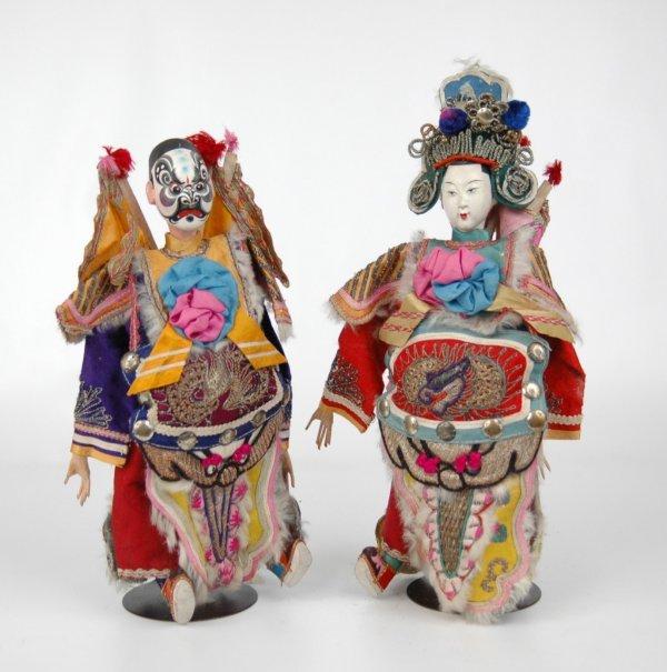 24: Pair of Japanese dolls, dressed in performing costu