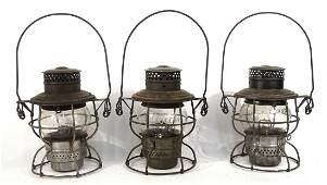 Three Adams and Westlake Co. railroad lanterns