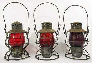Three Adams and Westlake Co. railroad lanterns