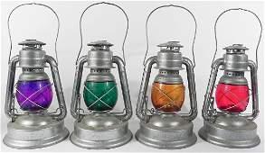 Four W.T. Kirkman railroad style safety lanterns