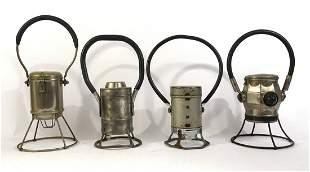 Four assorted electric railroad lanterns